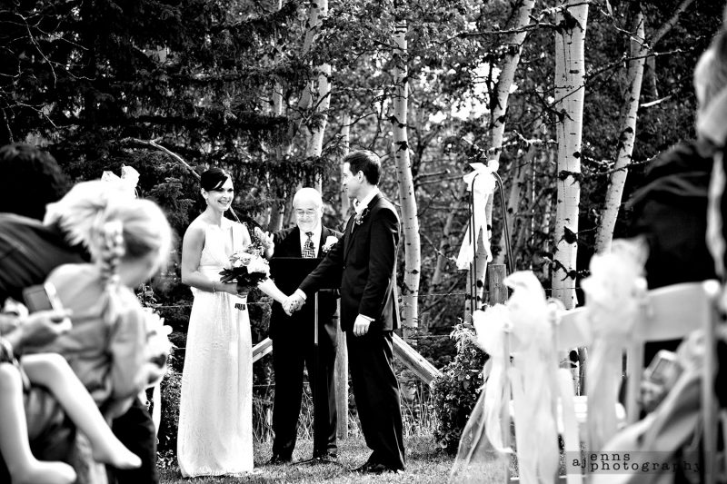 The couple saying their vows in the mountain valley