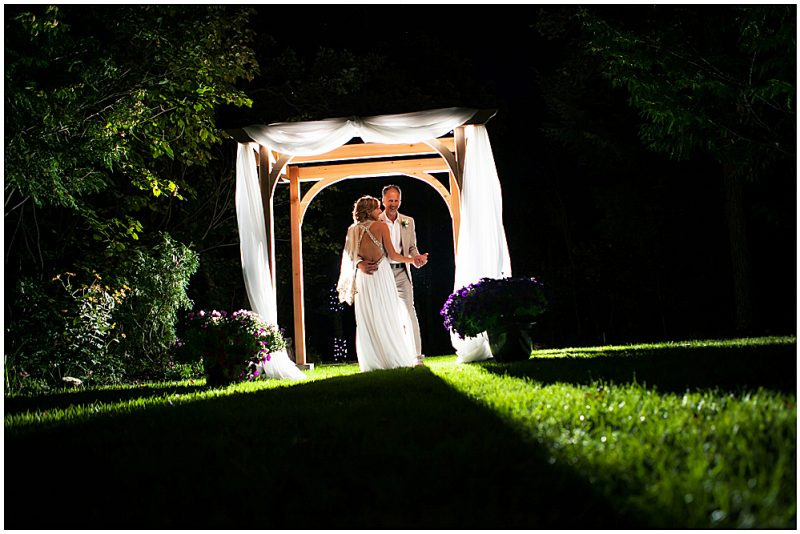 Amazing back lit shot of the couple in their arbor