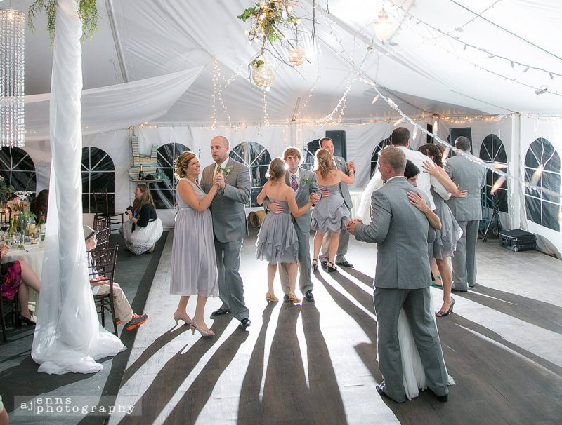 Wedding party dance under the tent at Pineridge Hollow