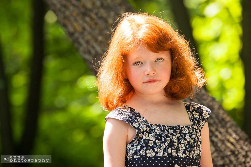 Young red haired girl in the afternoon sun