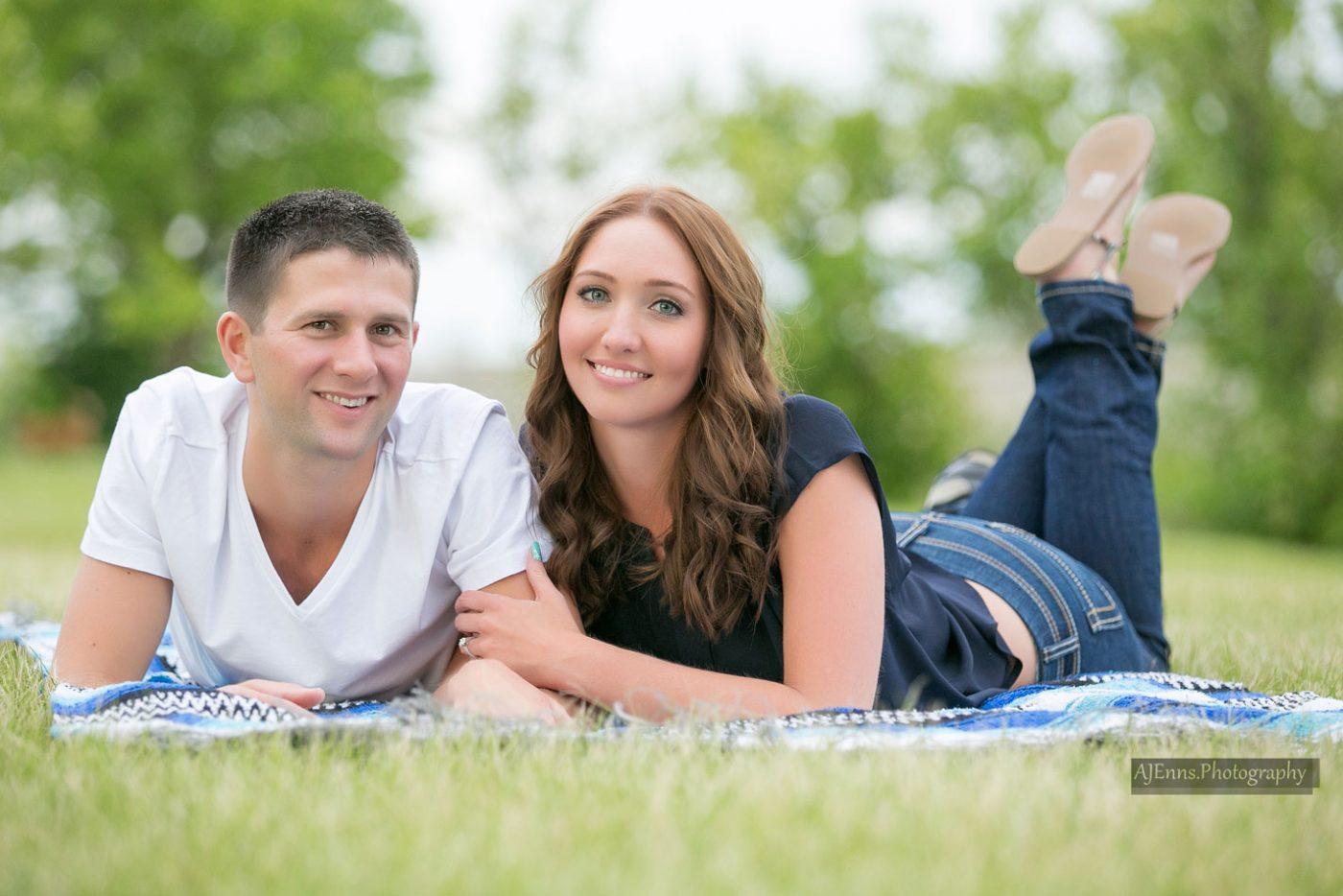 Kristen and Matthias laying on a blanket in Kilcona Park