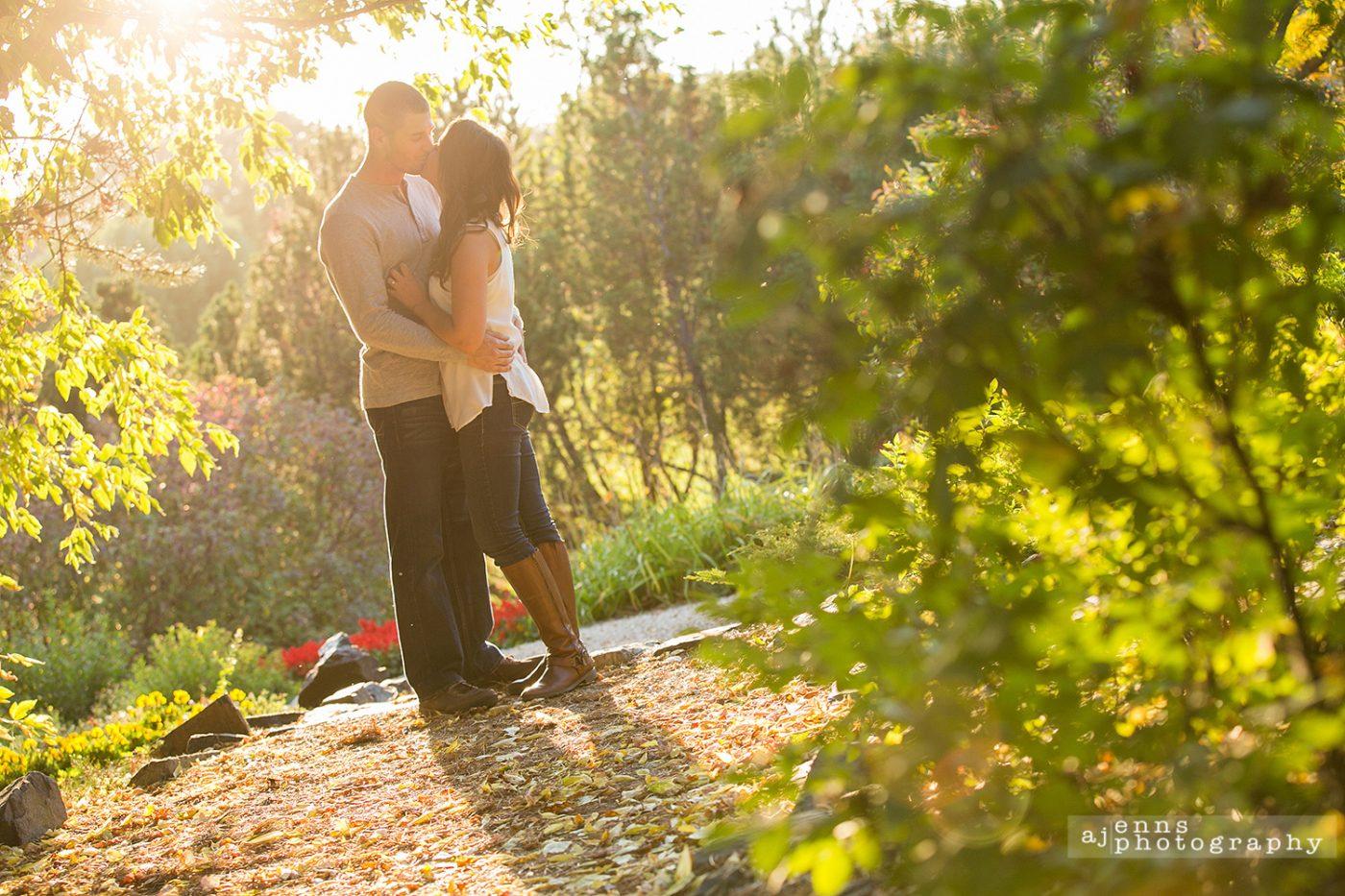 Kaitlan & Craig kissing in the golden hour in Kings Park