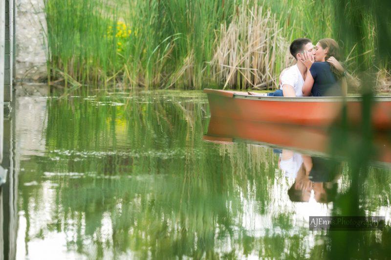 Romance in a canoe in perfectly still water at Kilcona Park, Winnipeg