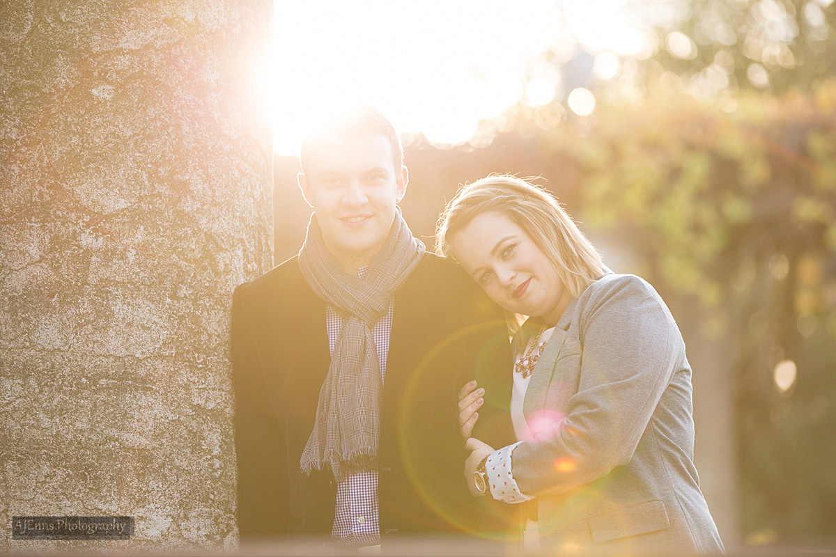 Sarah and Justin back lit by the Sun for engagement photos in Assiniboine Park