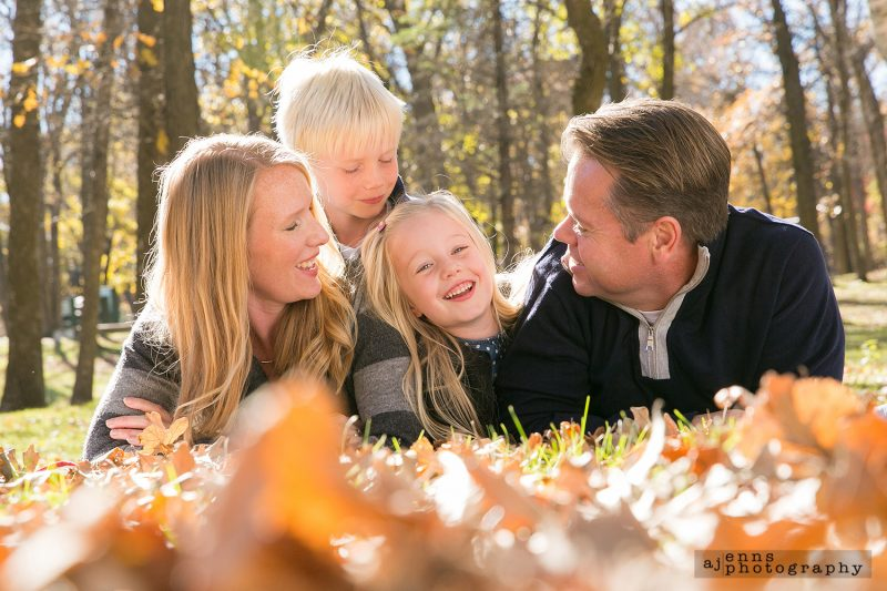 The Ens family rolls in the leaves
