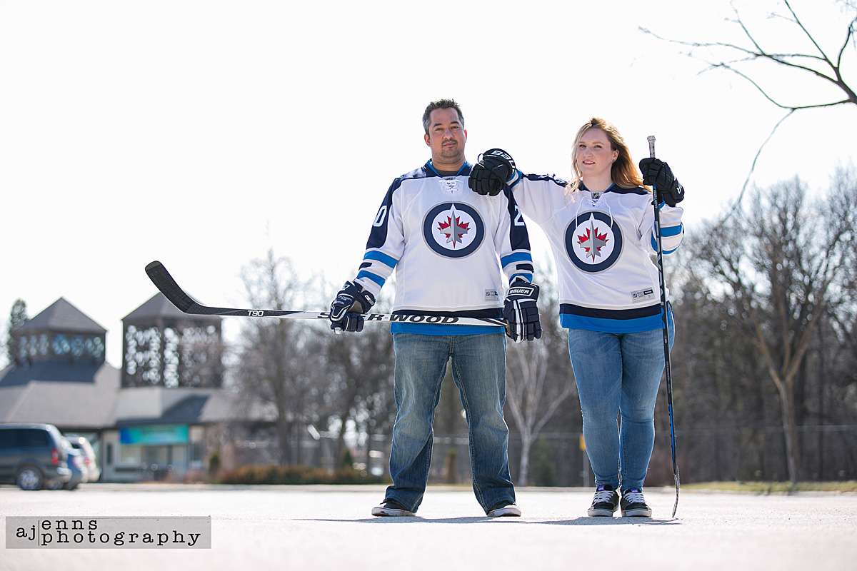Proudly wearing their Jets jerseys for their engagement photos