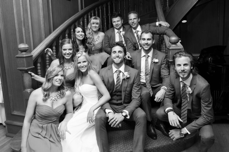 The wedding party on the grand stair case at St. Charles Country Club