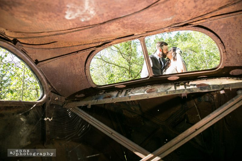 Kissing from viewed from within an abandoned car