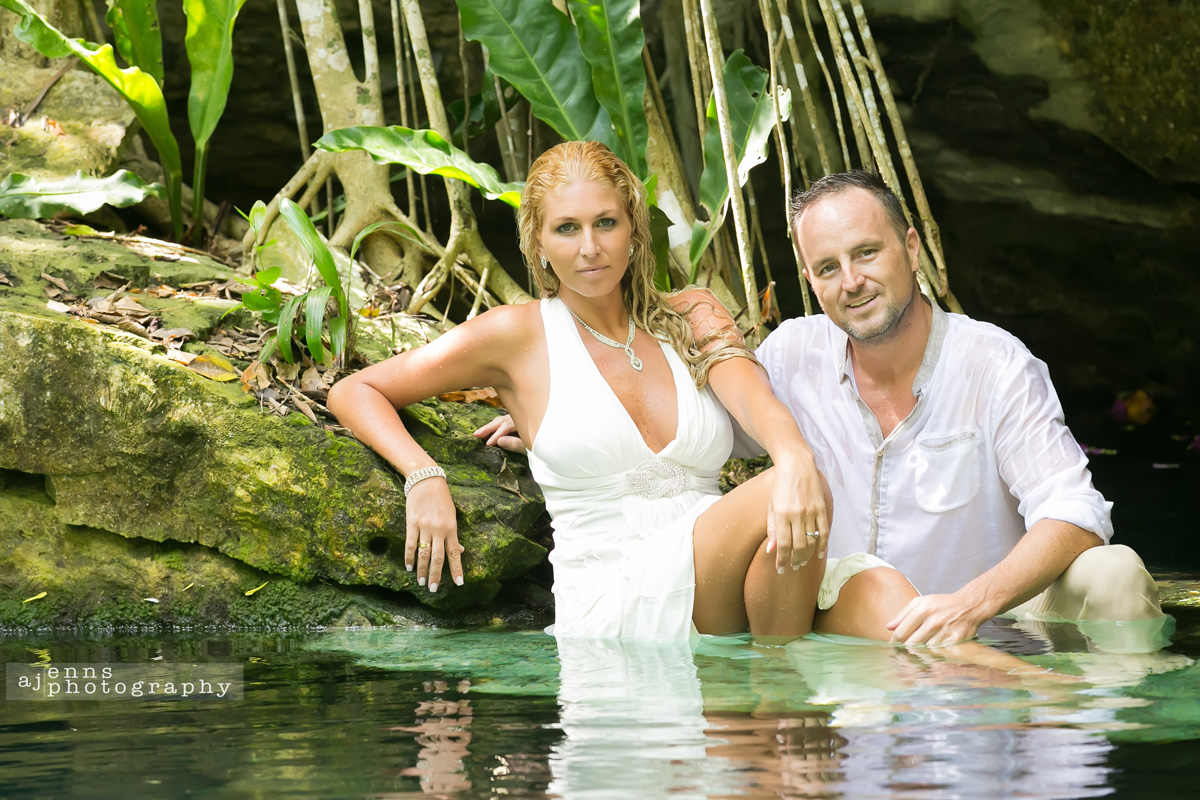 Silvie and Lincoln looking striking while sitting waste deep in a cenote in Mexico