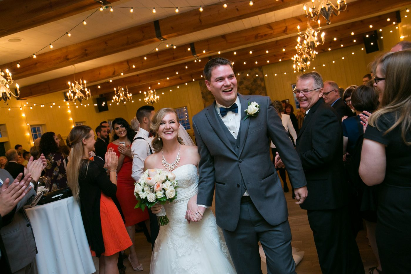 Big smiles as the couple walks out