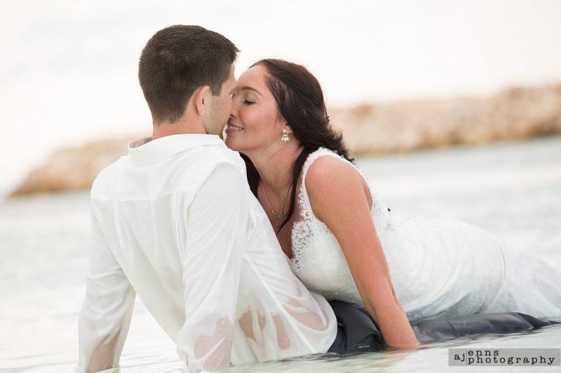 Kristen laying on Matthias lap giving him a big kiss