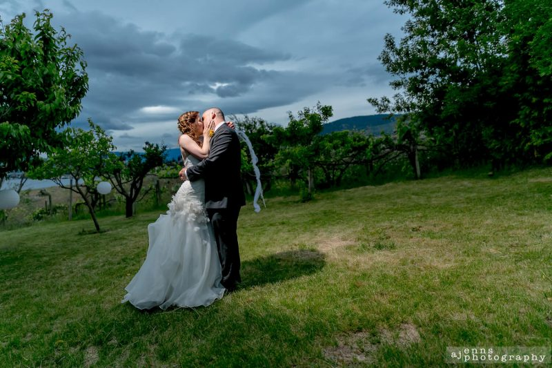 The couple under the lights in the open field at sunset