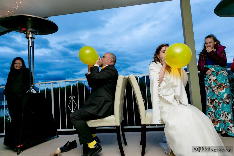 The couple racing to see who can blow up a balloon faster