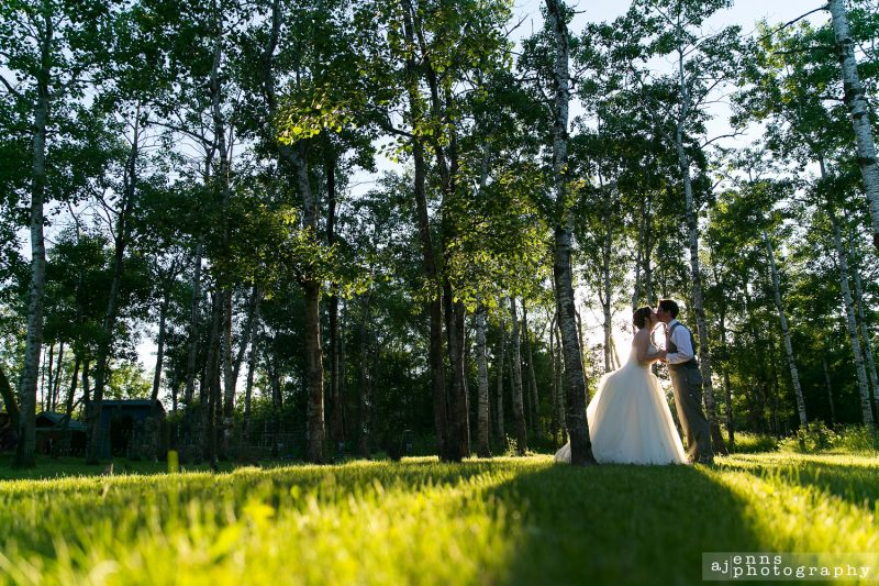 A romantic kiss silhouette in the forest at Pineridge Hollow
