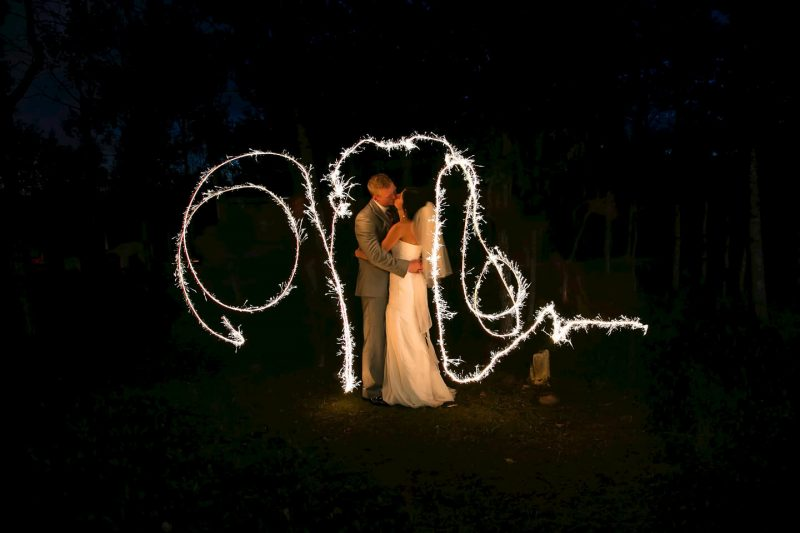 Kissing under the sparklers at Pineridge Hollow