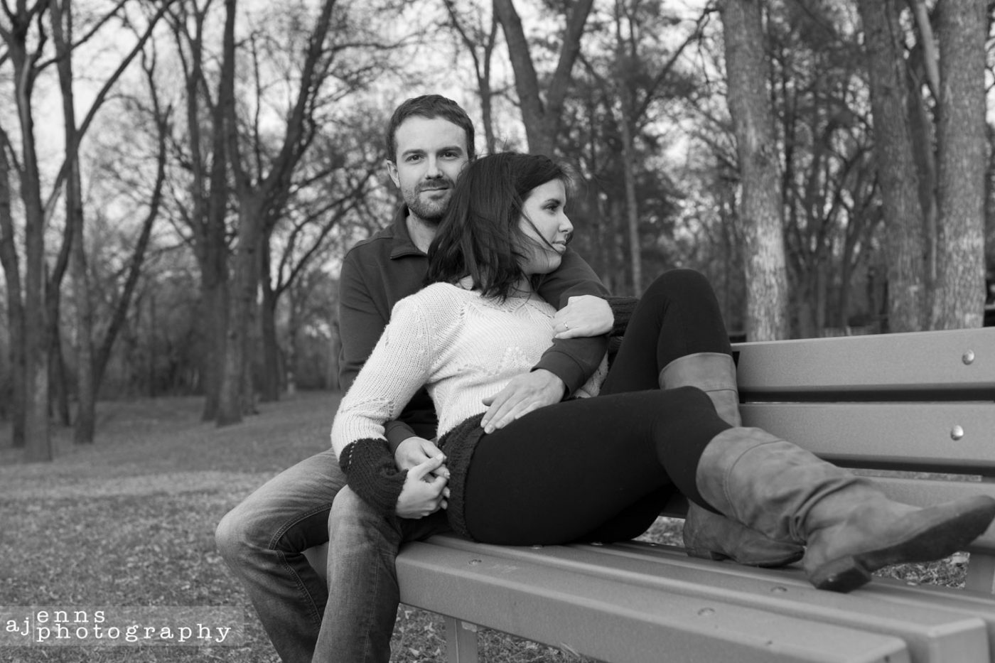 The two love birds sit on a park