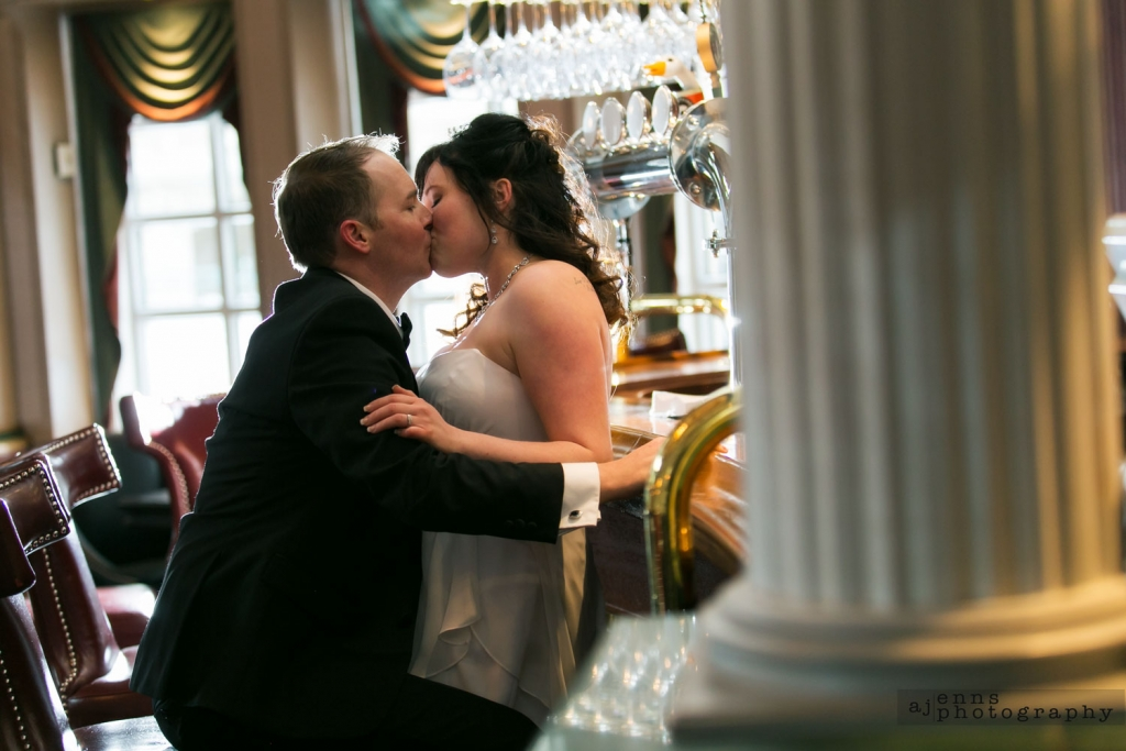 Romantic wedding kiss in the bar of the Hotel Fort Garry