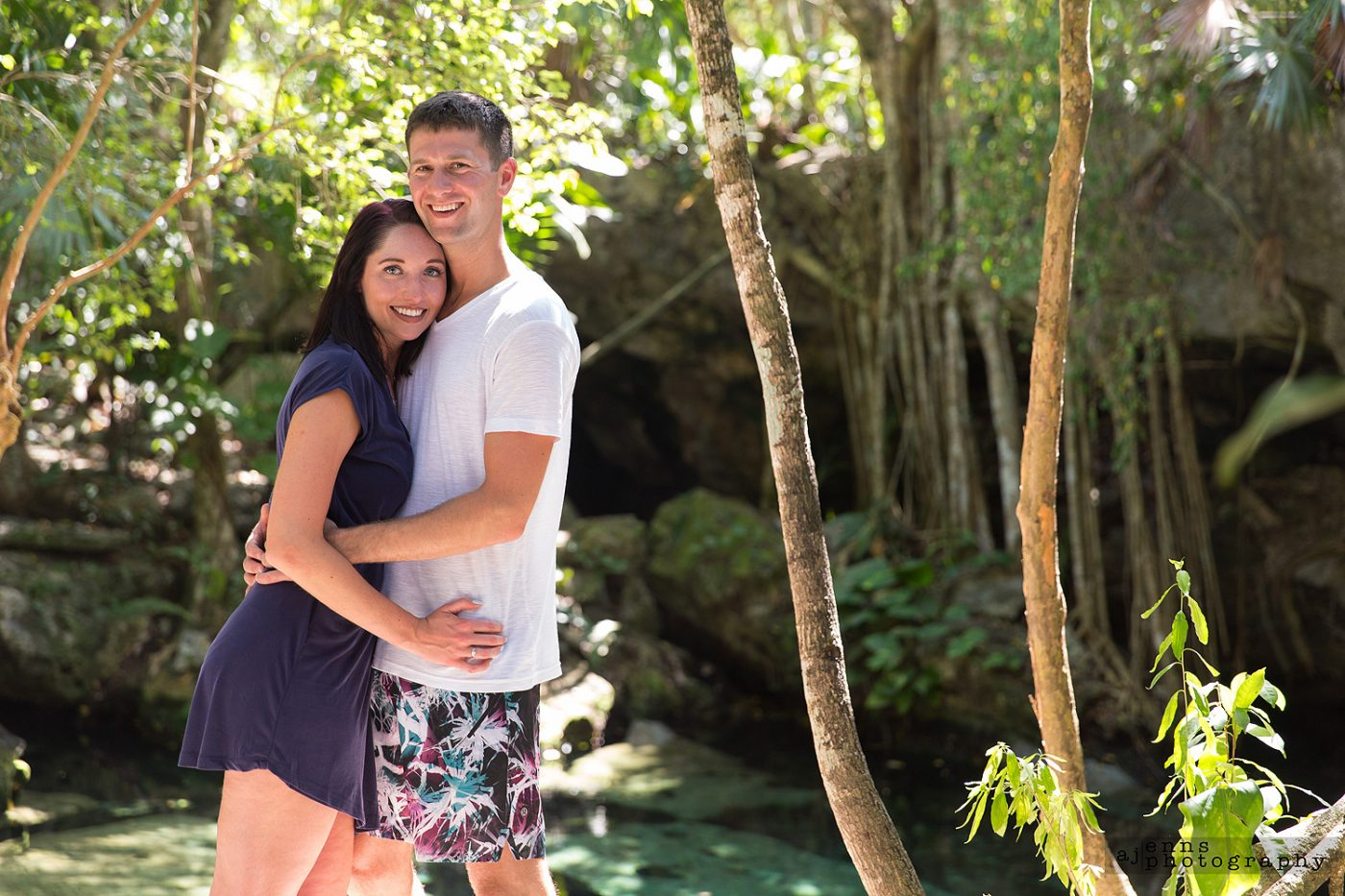 Kristen and Matthias embrace in the afternoon sunlight in the Mayan
