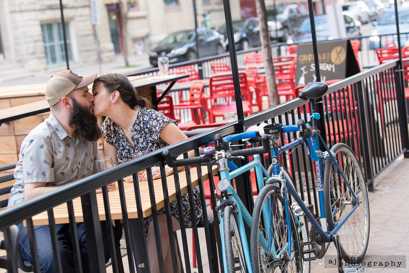 Enjoying a kiss on the patio at King and Bannatyne