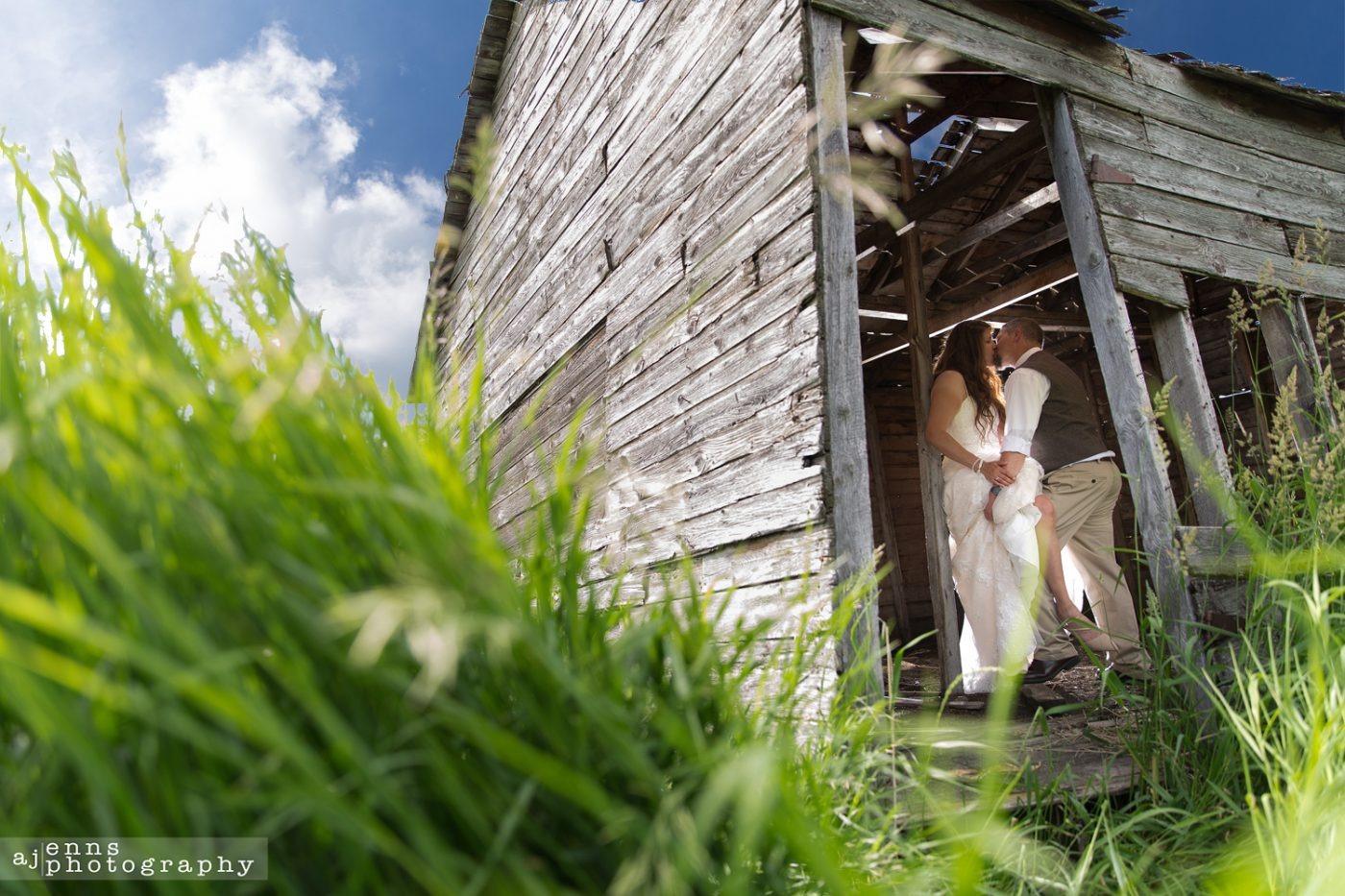 The bride and groom in a old decrepit building