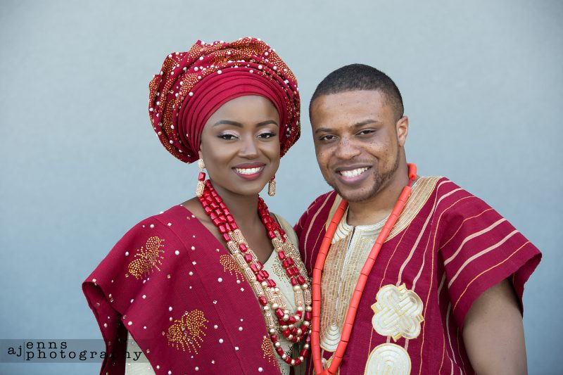 Sandra and Tayo wearing their second outfit, their African gowns