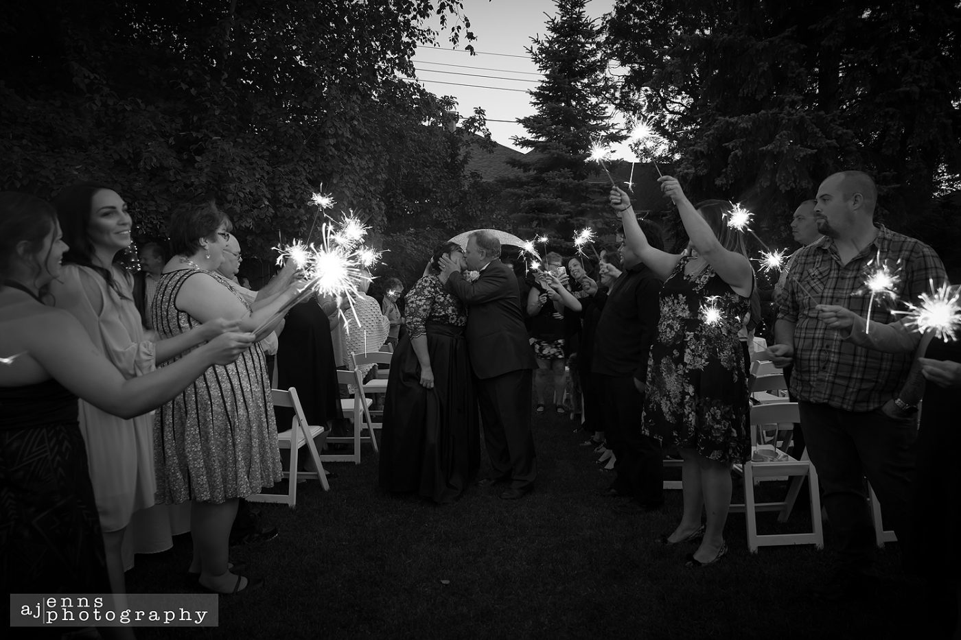 Walking out the isle to the guests holding sparklers