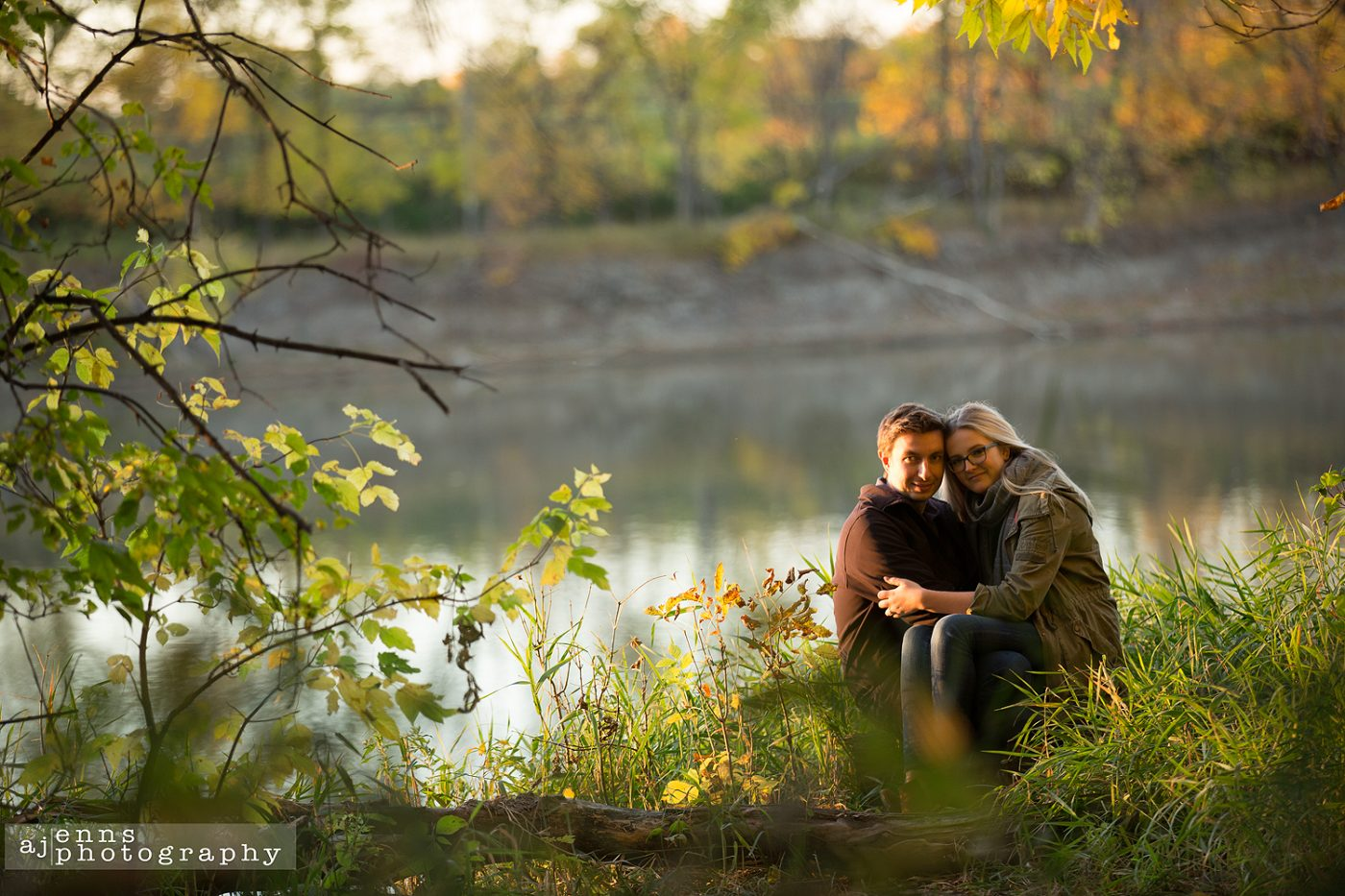 Chynna sitting on Tim's lap beside the river
