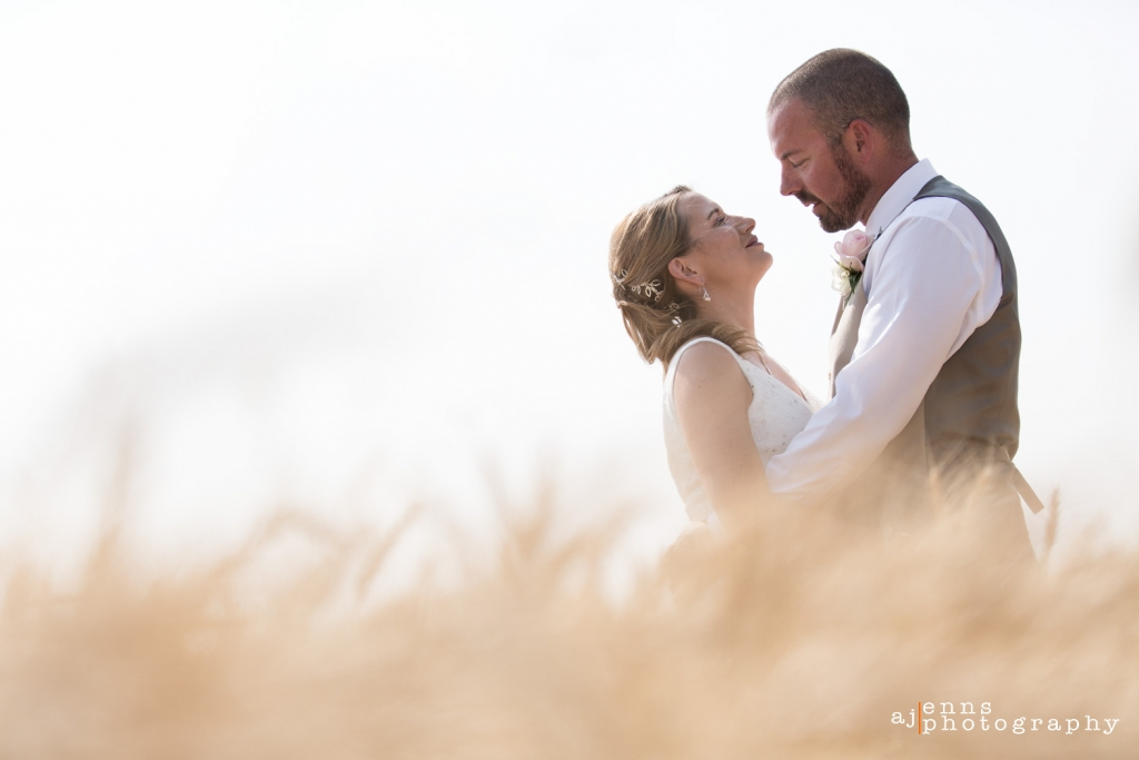 The couple looking into each others eyes in the wheat field