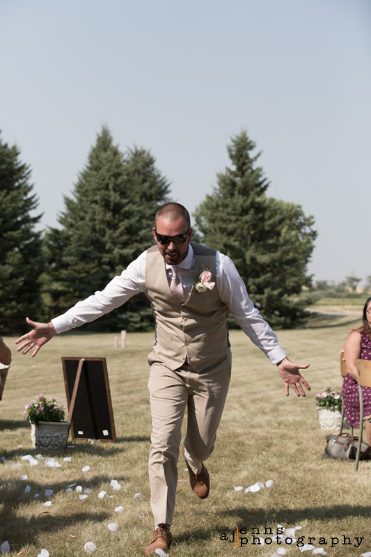 The groom running down the isle looking for high fives