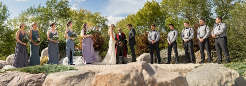 Wide angle of the ceremony on the stones at Hawthorn estates