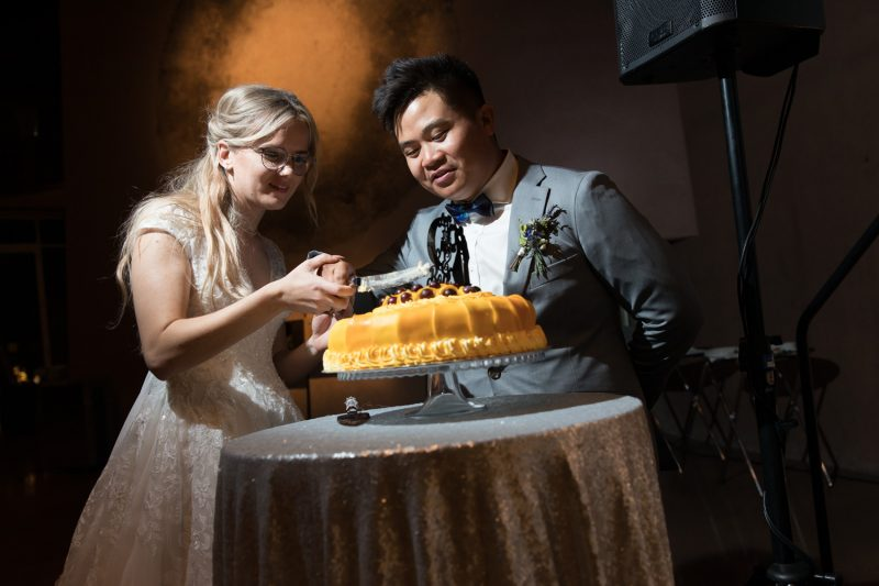 Cutting the wedding cake together
