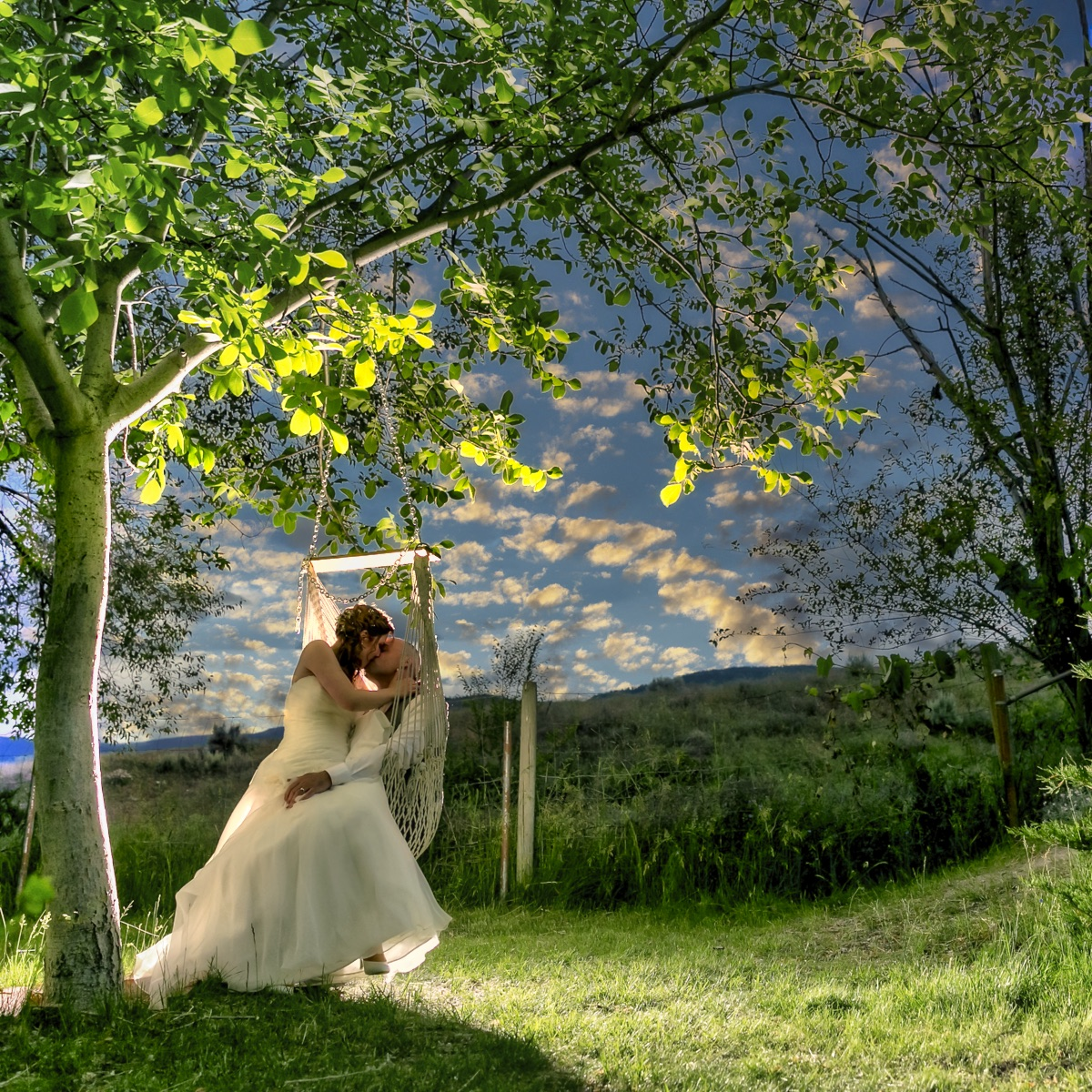 Bianca and Scott swinging on their wedding day at sunset