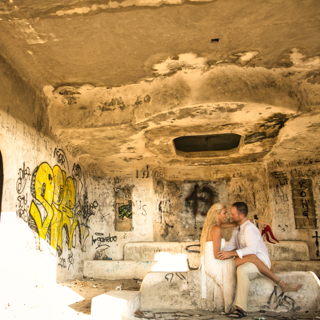 Silvie sitting on Lincoln's lap in an abandoned house on the beach in Playa del carmen