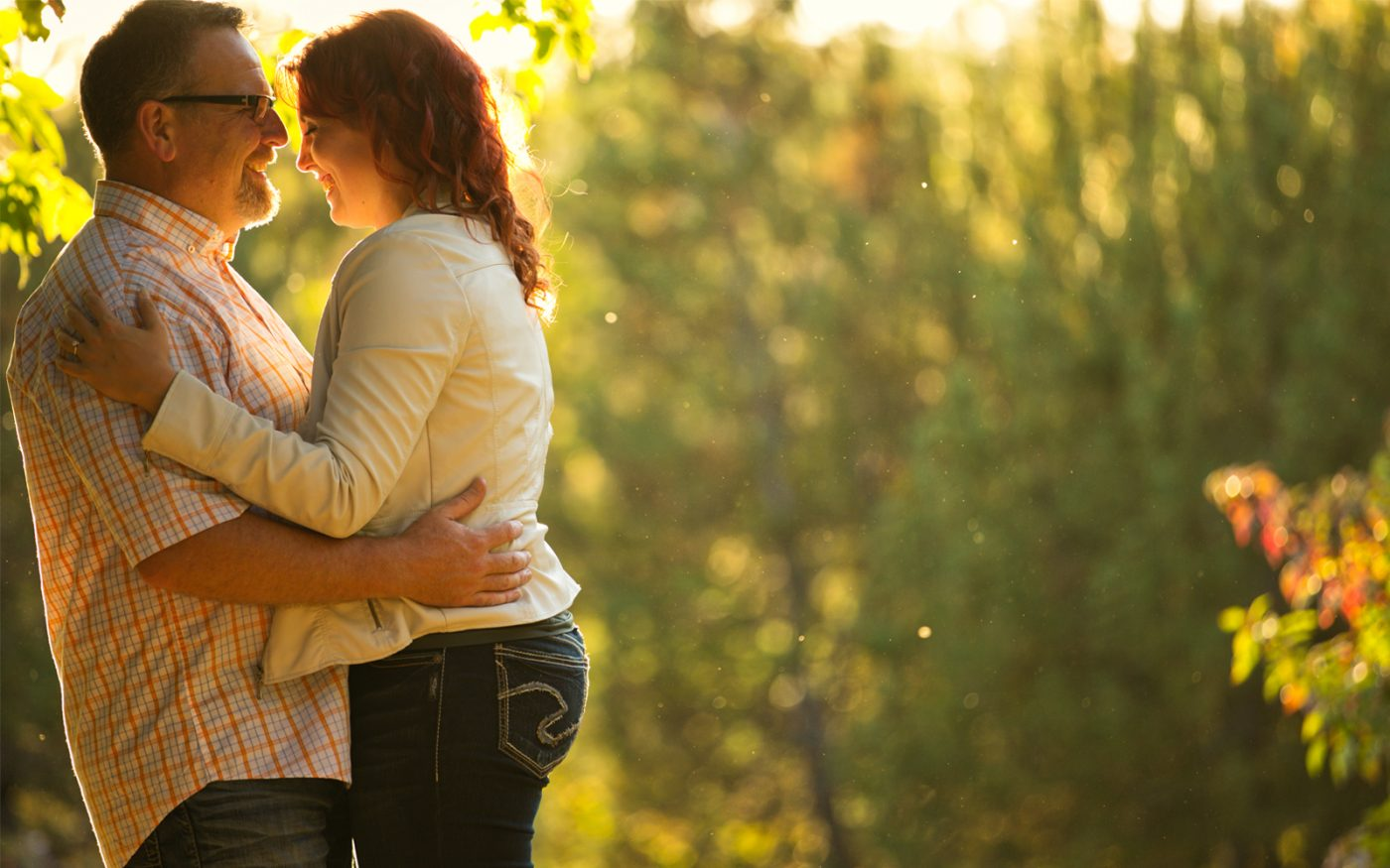 Kelsey and Gord snuggle during their sunset engagement