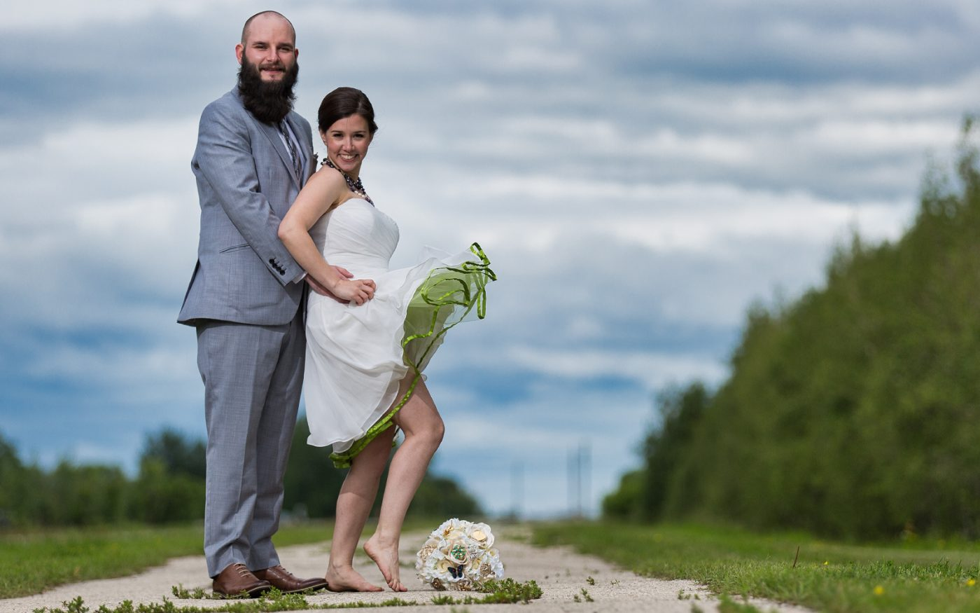 Sam and David kick off their shoes and have fun during the newlywed session