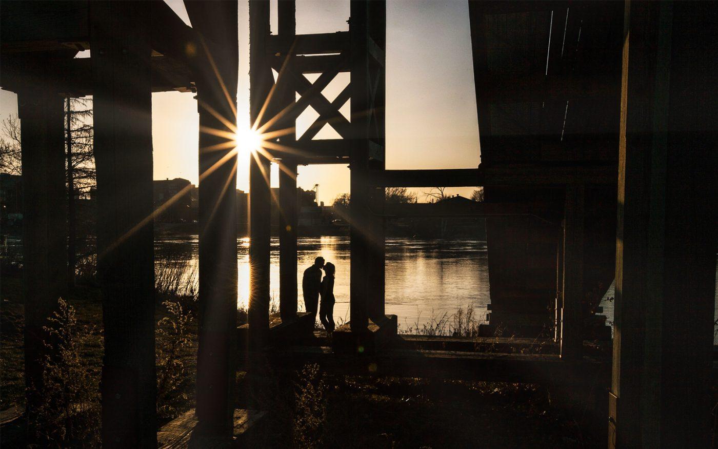 Kissing under the toboggan bridge at sunset